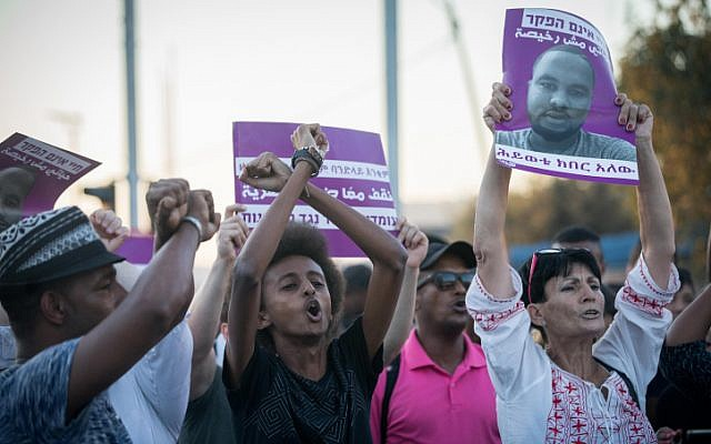 Ethiopian Israelis and supporters protest following the death of 19-year-old Ethiopian, Solomon Tekah who was shot and killed by an off-duty police officer, in Jerusalem on July 2, 2019. (Yonatan Sindel/Flash90)