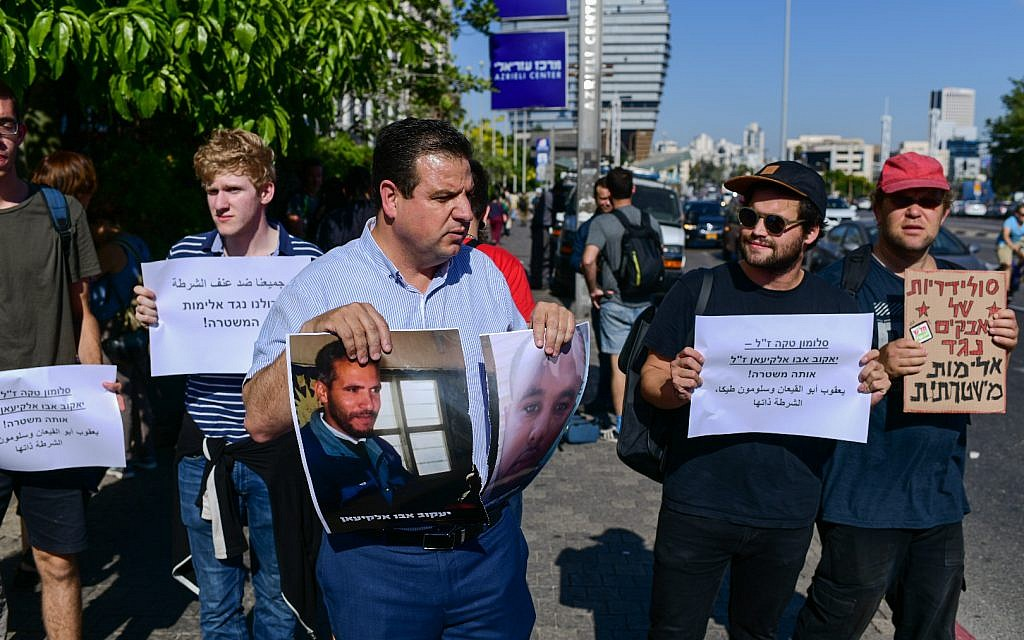 Hadash party MK Ayman Odeh joins an Ethiopian-Israeli protest against police violence in Tel Aviv, July 3, 2019. (Tomer Neuberg/Flash90)