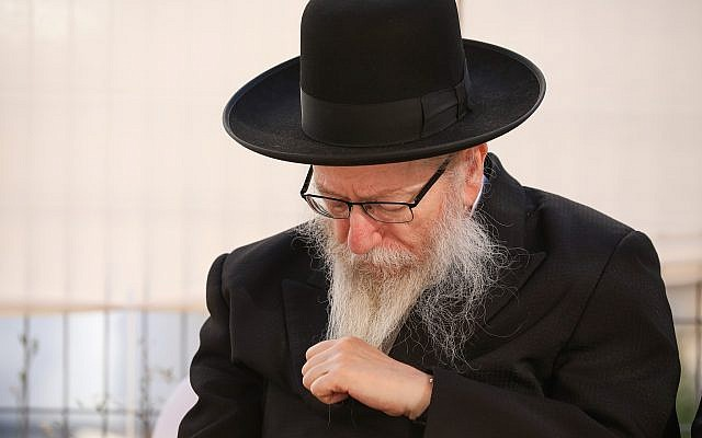 Deputy Health Minister Yaakov Litzman at the ceremony for the opening of a new branch of his Agudath Israel party, ahead of the upcoming elections, in the northern city of Safed, July 4, 2019. (David Cohen/Flash90)