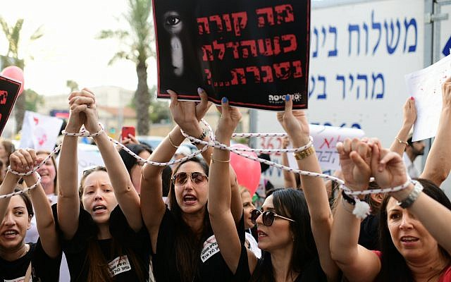 Parents protest against the abuse of children in private daycare centers in Tel Aviv on July 7, 2019. The sign reads 'What happens when the door is closed?' (Tomer Neuberg/Flash90)