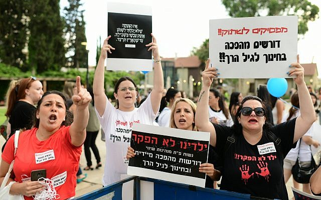 Parents protest against the abuse of children and infants in kindergartens in Israel in Tel Aviv on July 7, 2019. (Tomer Neuberg/Flash90 )