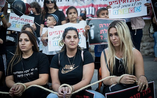 Parents protest with their children against the neglect of the safety of small children in kindergartens, outside the Prime Minister Residence in Jerusalem, July 7, 2019. (Yonatan Sindel/Flash90)
