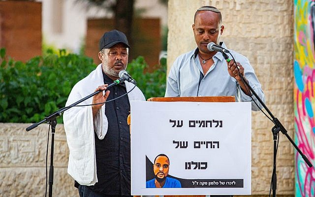 Worka Tekah speaks at a memorial ceremony for his son Solomon Tekah, who was shot dead by an off-duty police officer, in Haifa on July 10, 2019. (Flash90)