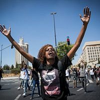 Ethiopian-Israelis and supporters demonstrate against police violence and discrimination following the death of 19-year-old Solomon Tekah, who was shot and killed in Haifa by an off-duty police officer; Jerusalem, July 15, 2019. (Yonatan Sindel/Flash90)