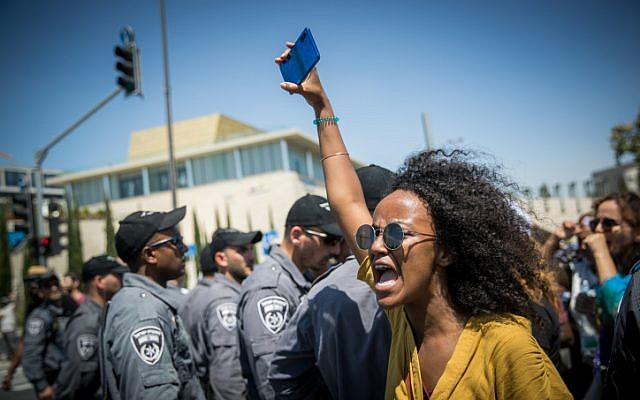 Ethiopians and supporters demonstrate against police violence and discrimination following the death of 19-year-old Ethiopian, Solomon Tekah who was shot and killed few days ago in Kiryat Haim by an off-duty police officer, in Jerusalem, July 15, 2019. (Yonatan Sindel/Flash90)