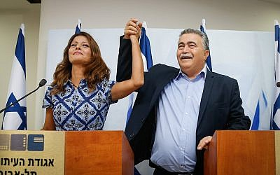 Gesher party chair Orly Levy-Abekasis (L) and Labor head Amir Peretz announce their joint run in the September election, in Tel Aviv, July 18, 2019. (Roy Alima/Flash90)