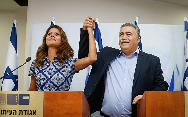 Gesher party chair Orly Levy-Abekasis (L) and Labor head Amir Peretz announcing their joint run in the September election, in Tel Aviv, July 18, 2019. (Roy Alima/Flash90)