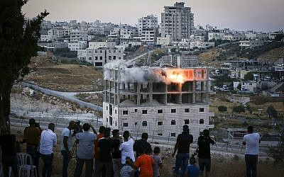 A Palestinian building is blown up by Israeli forces in the village of Sur Baher, southern Jerusalem on July 22, 2019,  (Wisam Hashlamoun/Flash90(