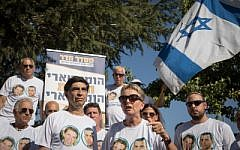 Bereaved parents of Hadar Goldin and other family members and supporters gather outside the state memorial ceremony for Operation Protective Edge at Mount Herzl on July 23, 2019. (Noam Revkin Fenton/Flash90)