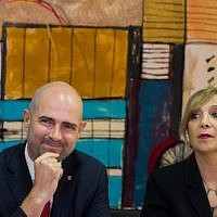 Justice Minister Amir Ohana (L) with Justice Ministry director general Emi Palmor during a welcome ceremony for Ohana at the ministr in Jerusalem on June 23, 2019. (Yonatan Sindel/Flash90)