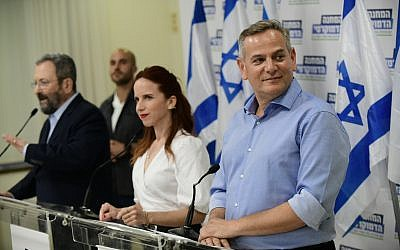 Meretz party chairman Nitzan Horowitz (right), former prime minister and leader of Israel Democratic party Ehud Barak and MK Stav Shaffir hold a press conference announcing their newly formed Democratic Camp political alliance, in Tel Aviv on July 25, 2019 (Tomer Neuberg/Flash90)