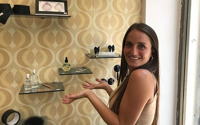 Chana Boteach posing in front of some accessories at her Kosher Sex store in Tel Aviv, July 10, 2019. (Shoshanna Solomon/Times of Israel)