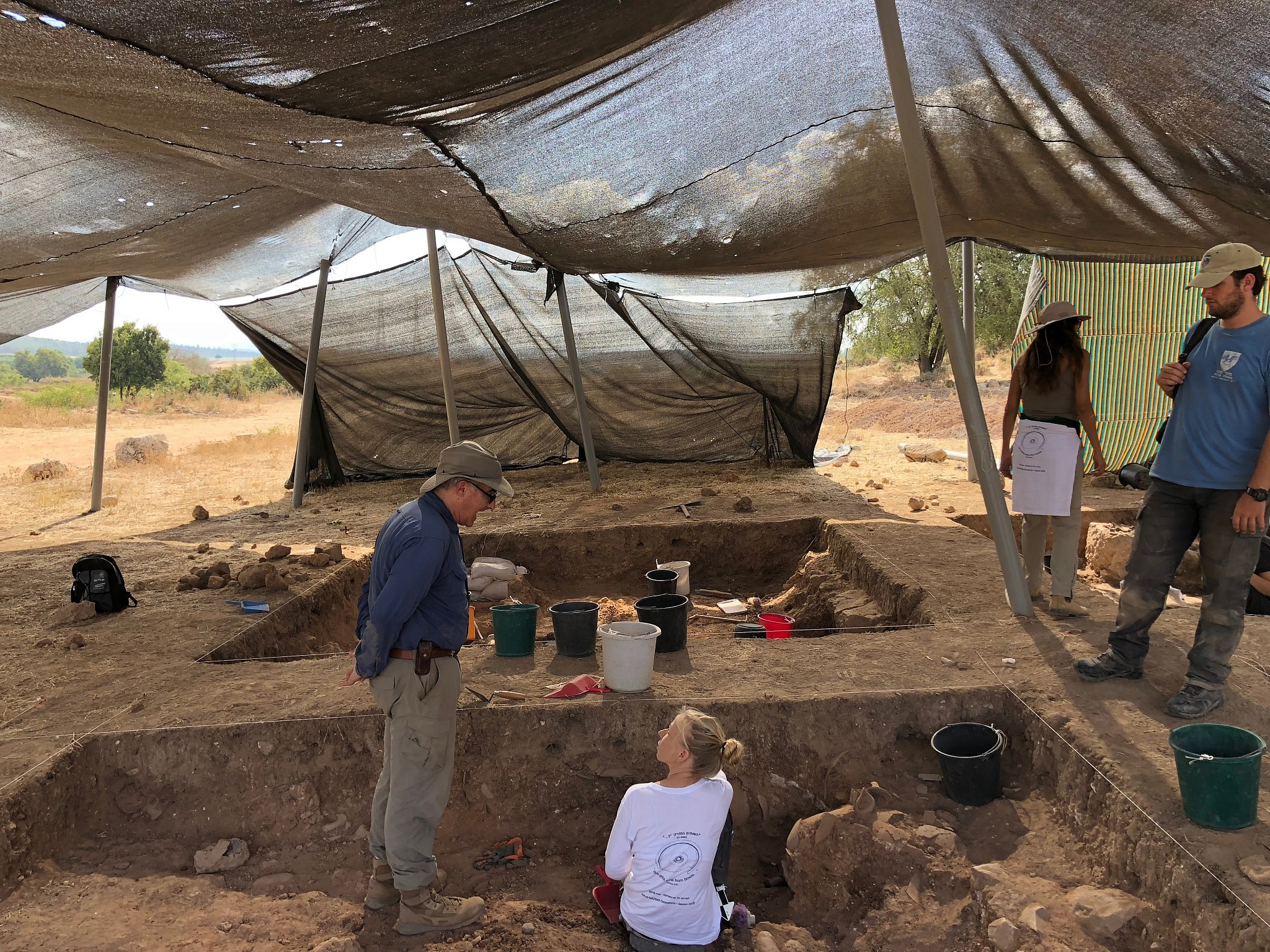 Archaeologist Aren Maeir left) supervises at a 830 BCE destruction layer at the Tell es-Safi/Gath Archaeological Project, July 2018. (Amanda Borschel-Dan/Times of Israel)