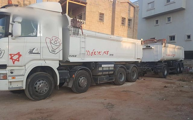 A truck in Kafr Qassem vandalized in an apparent hate crime attack on July 28, 2019. (Israel Police)
