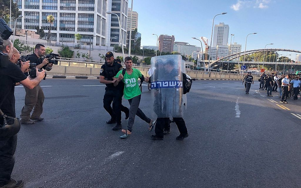 A Meretz party activist is detained by police at a protest by the Ethiopian-Israeli community in Tel Aviv, July 3, 2019. (Naomi Lanzkron)