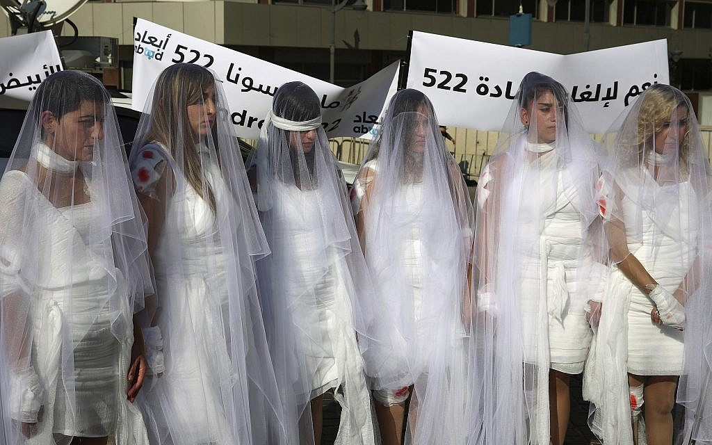 A protest in Lebanon against a law absolving a rapist if he marries his victim. (AP Photo/Hassan Ammar)