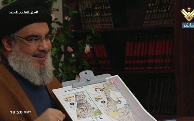 Hezbollah leader Sheikh Hassan Nasrallah points to a map of Israel, and specifies potential targets, in a July 12, 2019, TV interview. (Channel 13 screenshot)