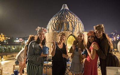 Crocheting a cover for a Mamluk dome at the Tower of David Museum in Jerusalem as part of 'Overall,' a three-day fashion event in July 2019 (Courtesy Ricky Rachman)