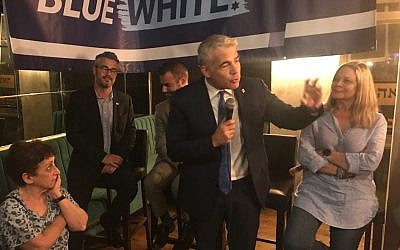 Blue and White number two Yair Lapid at a party campaign event for English speakers in Tel Aviv, July 1, 2019. (Hannah Harnest/Times of Israel)