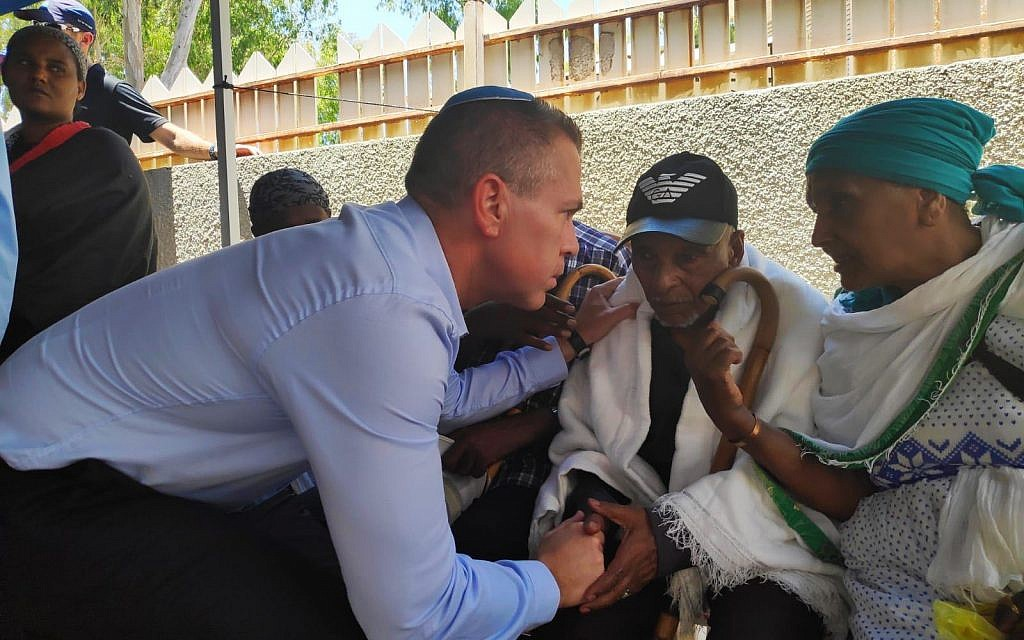 Public Security Minister Gilad Erdan consoles the family of Solomon Tekah, 19, who was shot dead by an off-duty police officer, sparking riots, July 4, 2019 (courtesy)