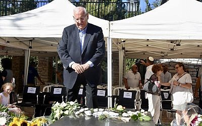 President Reuven Rivlin at the grave of his late wife Nechama at Jerusalem's Mount Herzl for the unveiling of her tombstone 30 days after her passing, on July 4, 2019. (Courtesy Tomer Reichman)