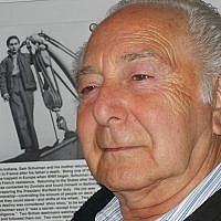 Sam Schulman in front a photo of himself at an exhibition of the 'Exodus' at the Virginia Holocaust Museum in 2003 in Richmond, Virginia (Courtesy Schulman family)