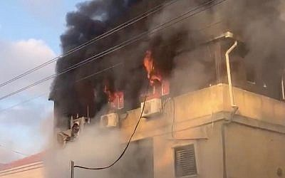 A fire burns at the home of Carmel Mouda in the central city of Rosh Ha'ayin on July 6, 2019. (Screen capture: Twitter)