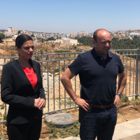 New Right chairwoman Ayelet Shaked (L) and party No 2. Naftali Bennett speak to reporters in the West Bank settlement of Efrat on July 22, 2019. (Jacob Magid/Times of Israel)