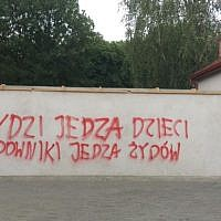 Vandalism at the newly renovated Jewish cemetery in Tarnow in southern Poland, July 2019. The graffiti reads, 'Jews eat children. Jadowniki eat Jews.' Jadowniki is a nearby village. (Facebook/Natalia Gancarz/via JTA)