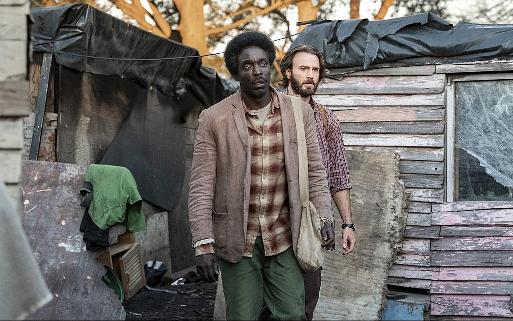 Michael K. Williams and Chris Evans in a screenshot from 'The Red Sea Diving Resort' trailer. (Netflix)