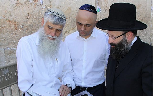 Britain's Home Secretary Sajid Javid, center, visits the Western Wall in Jerusalem, July 1, 2019. (Courtesy The Western Wall Heritage Foundations)