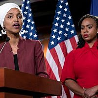 "US Rep. Ilhan Omar, D-Minn., left, joined at right by US Rep. Ayanna Pressley, D-Mass., responds to remarks by President Donald Trump after he called for four Democratic congresswomen of color to go back to their ""broken"" countries, July 15, 2019. (AP Photo/J. Scott Applewhite)"