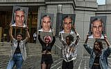 Protesters hold up signs of Jeffrey Epstein in front of the federal courthouse on July 8, 2019, in New York City. (Stephanie Keith/Getty Images/AFP)