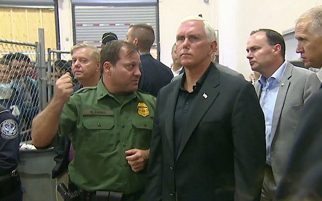 Pence tour of migrant center shows men crowded in cages
