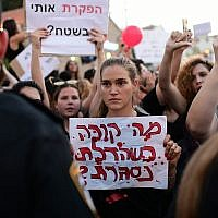 "Parents protest in Tel Aviv against the abuse of children and infants in kindergartens in Israel, July 7, 2019. The sign reads ""What happens when the door closes?"" (Tomer Neuberg/ Flash90)"