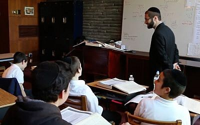 A classroom at Yeshiva Toras Chaim in Norfolk, Virginia. One of the school's teachers, Rabbi Reuven Bauman, went missing on July 9, 2019, when he jumped in the ocean to help a struggling student return to shore. (YouTube screenshot)