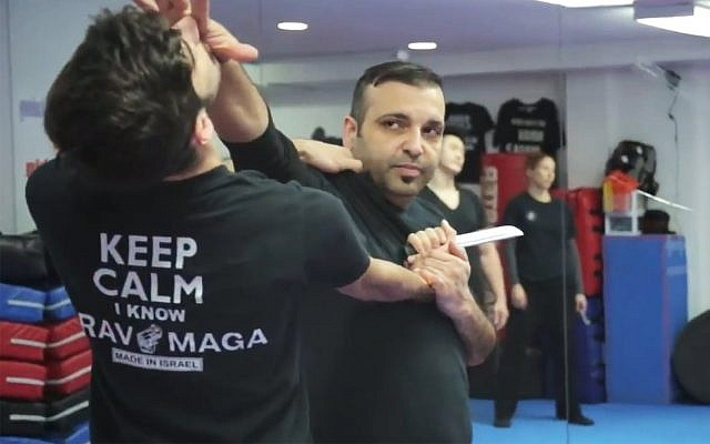 Avi Abraham, a Krav Maga instructor who teaches self-defense classes to synagogue-goers, shows how to combat an attacker in a promotional video. (YouTube screenshot)