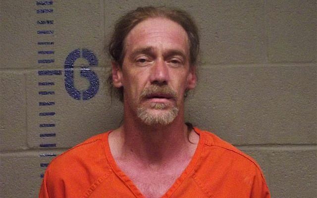 Stephen Jennings after police say they found in his car a rattlesnake, a canister of radioactive powdered uranium and an open bottle of Kentucky Deluxe whiskey during a traffic stop. (Logan County, Oklahoma Sheriff's Office via AP)