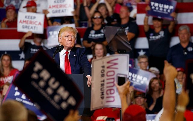 US President Donald Trump pauses  at a campaign rally at Williams Arena in Greenville, N.C., July 17, 2019. (AP Photo/Carolyn Kaster)
