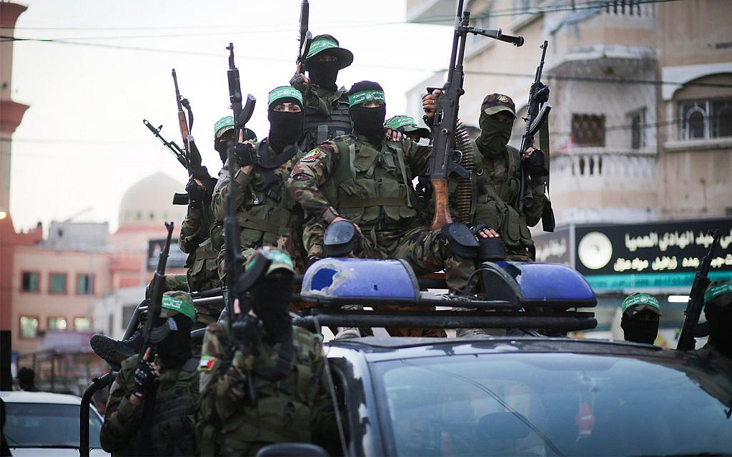 Members of the Izz-a-din al-Qassam Brigades, the military wing of the Islamist terror group Hamas, take part in a march in Gaza City, July 25, 2019. (Hassan Jedi/Flash90)