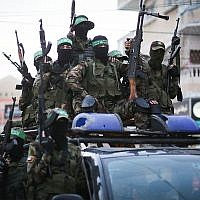Members of the Ezzedine al-Qassam Brigades, the military wing of the Islamist terror group Hamas, take part in a march in Gaza City, July 25, 2019. (Hassan Jedi/Flash90)