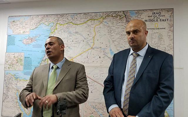 Hebron-area businessmen Ashraf Jabari (R) and Ashraf Ghanem (L) speaking at a press conference in central Jerusalem on July 2, 2019. (Adam Rasgon/Times of Israel)