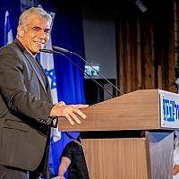 Blue and White No. 2 Yair Lapid addressing party activists in the coastal town of Shefayim, July 14, 2019. (Jane Peimer)