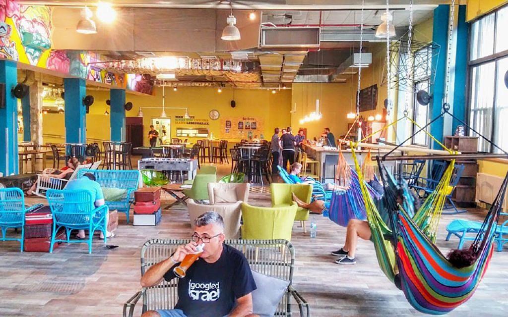 The homey, spacious lounge area of Abraham Hostel Tel Aviv, the chain's third location (Courtesy Abraham Hostel)