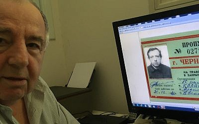 "Chernobyl ""liquidator"" Alexander Kalentyrsky, a construction engineer who helped build the concrete base of the Chernobyl sarcophagus in 1986, at his home in Bat Yam, June 26, 2019. His computer shows documentation from his period working at Chernobyl. (Times of Israel staff)"