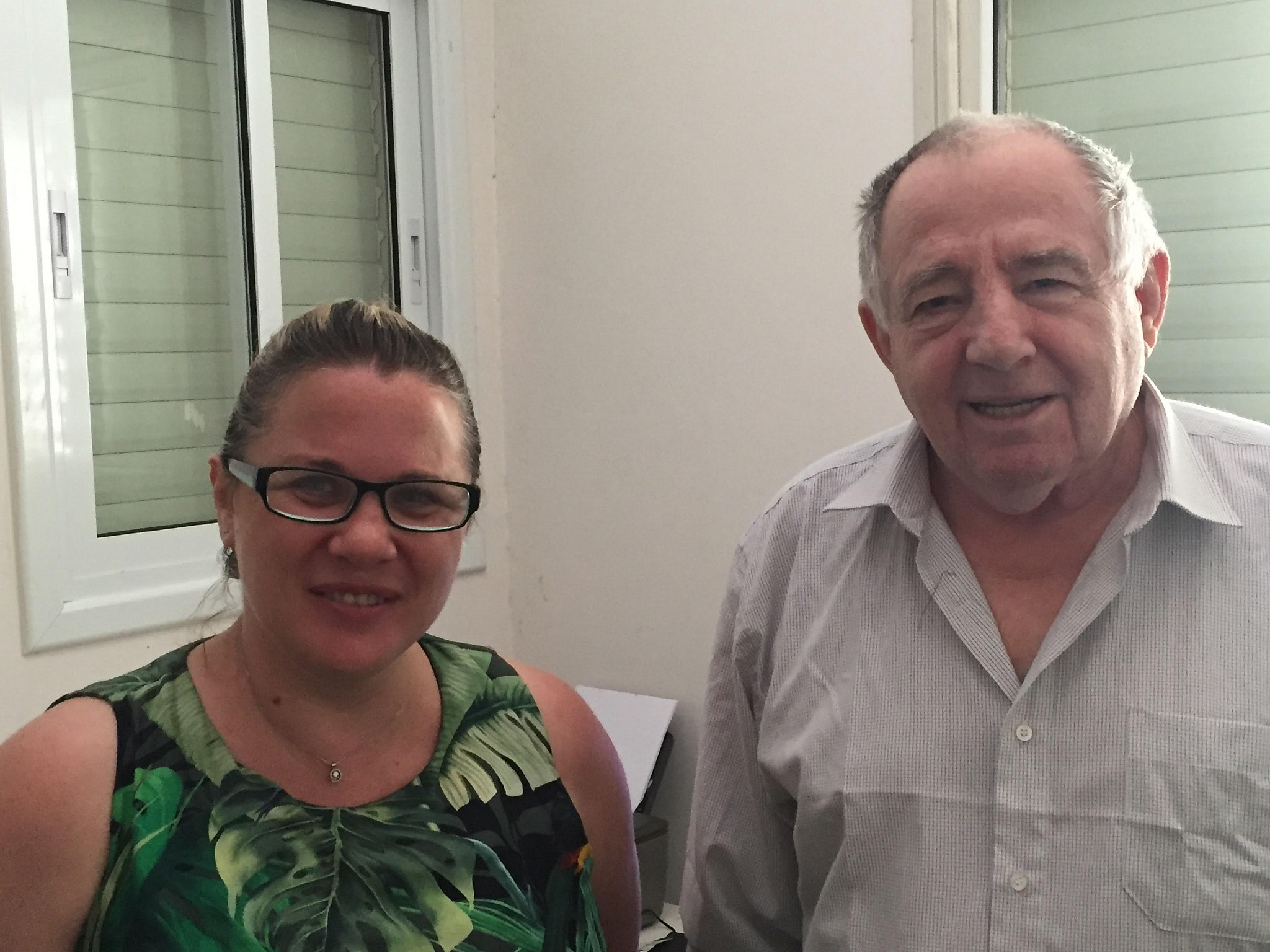 Alexander Kalentyrsky, a construction engineer who helped build the concrete base of the Chernobyl sarcophagus in 1986, at his home in Bat Yam alongside former MK Ksenia Svetlova, June 26, 2019 (ToI staff)