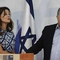Gesher party chair Orly Levy-Abekasis (L) and Labor head Amir Peretz announce their joint run in the September election, July 18, 2019 (screenshot)