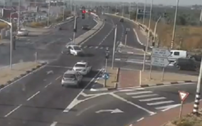 A child tumbles out of a car as it crosses an intersection near Kochav Ya'ir (screenshot)