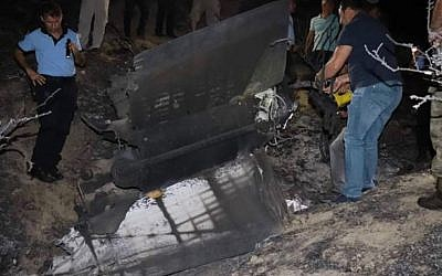 Authorities in northern Cyprus examine the wreckage of a mystery object that crashed causing a large explosion on July 1 2019 (Screencapture/Twitter)