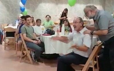 A Jewish Home party activist shouts criticism of the merger with New Right during a gathering in Jerusalem, July 29, 2019 (screenshot)